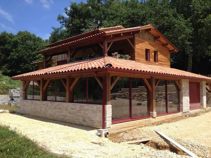 Installation de fenêtres mixte bois / alu minium dans le var